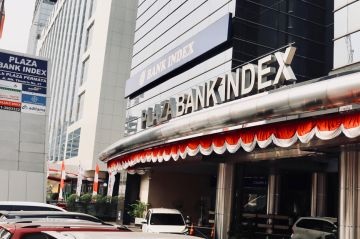 Plaza Bank Index with the new letter signage installed at building canopy
